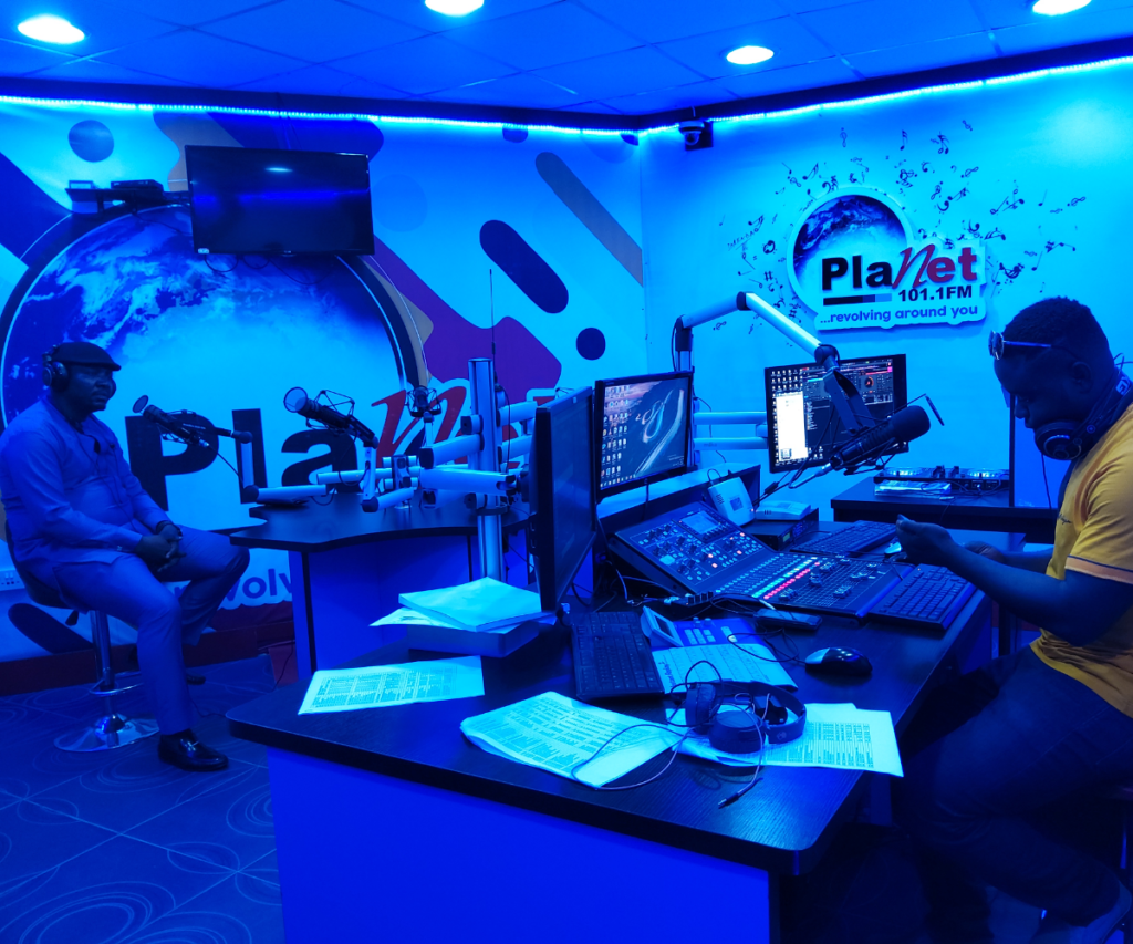 From far left - Comrade Dominic Abang, At Planet 101.1 FM during the programme